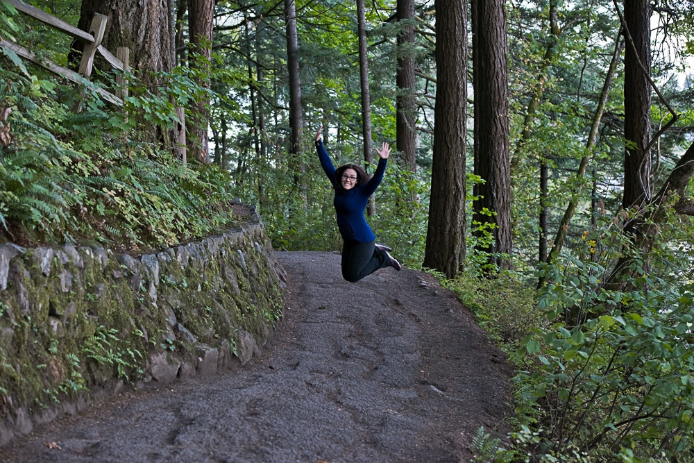 Brooke jumping as we near the end of the 11 switchbacks on the Multnomah-Wahkeena trail