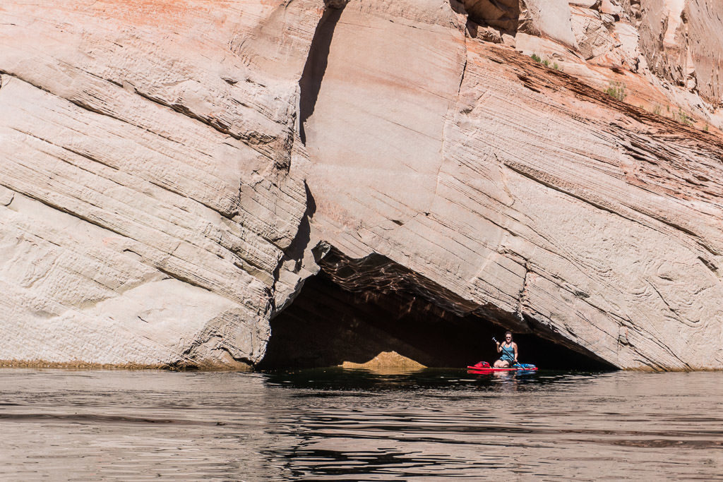 Brooke on her paddleboard in a mini cave we found while paddleboarding on Lake Powell