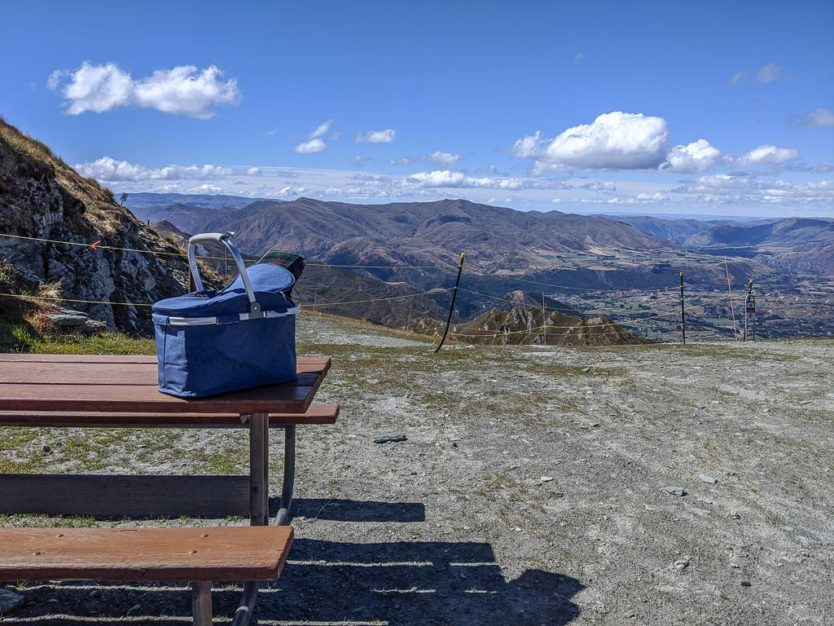 picnic basket and  mountain views from atop coronet peak